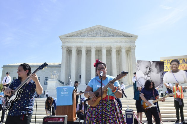 WASHINGTON, DC - APRIL 18:  Alex Bendana, La Marisoul and Miguel Ramirez of LA SANTA CECILIA perform during the Fight For Families Rally in front of the Supreme Court of the United States on April 18, 2016 in Washington, DC. (Photo by Kris Connor/Getty Images)